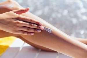 women applying sunscreen